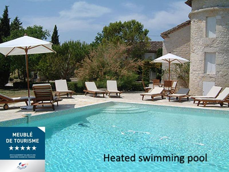 Heated swimming pool at 5* Manoir Les Gaillardoux - salted water, plenty of sun lounges. Gorgeous!