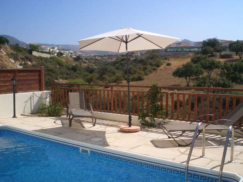Private pool overlooking countryside and other villas