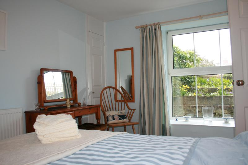The large windows let in lots of light and look out onto the pretty, private garden area.