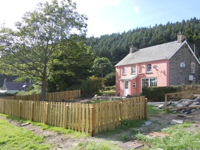 Fully refurbished cottage with enclosed lawned garden with patio and garden room.
