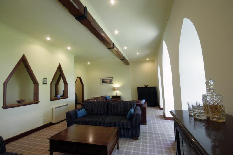 Large Gallery Lounge with original church beam and floor to ceiling cathedral styled windows