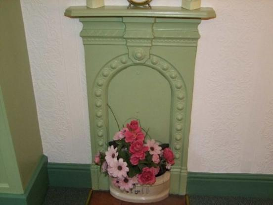 Charming little cast iron fireplace in the main Double Bedroom.