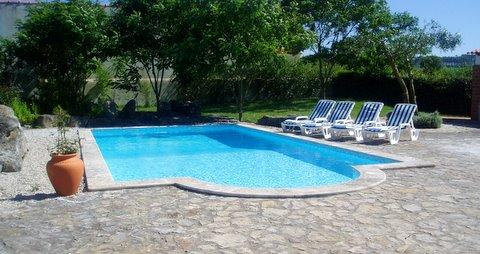 Relax with a book beside your private pool in your large established mediterranean garden.