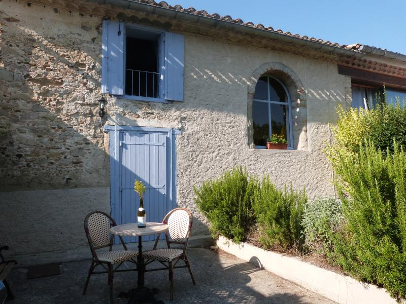 Front of house with sunny terrace- great for your morning coffee and croissant .