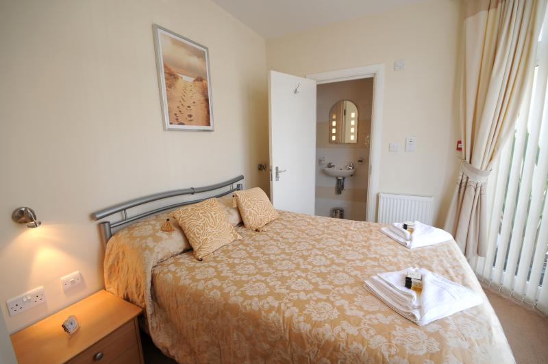 cosy bedroom with ensuite - which has a double shower