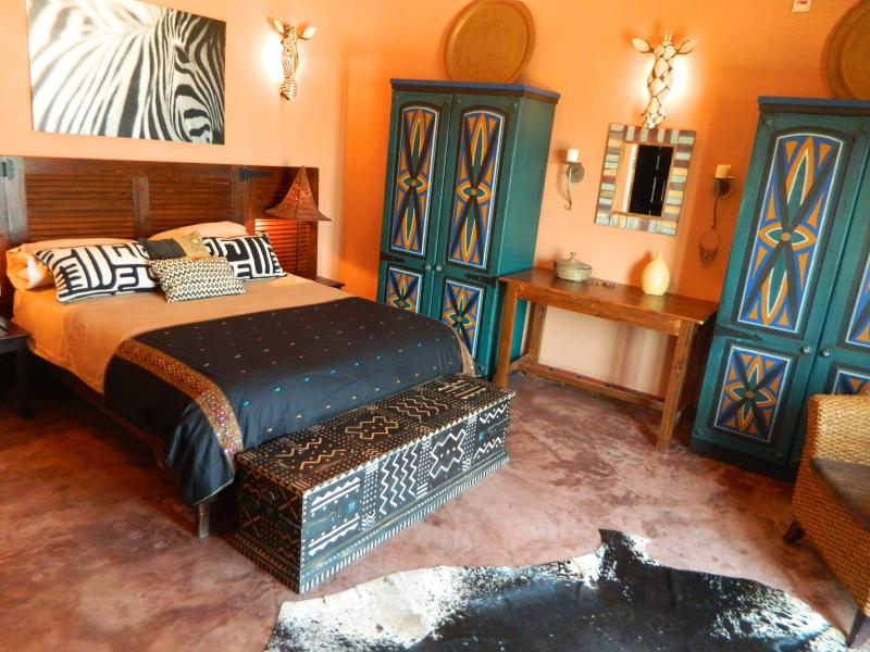 The main bedroom is big with double hand painted wardrobes and French doors that open up to the sea.