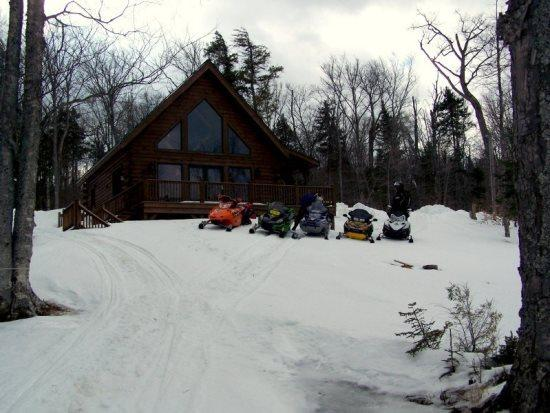 Snowmobiling from the Log cabin in the wintertime