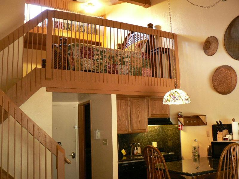 View of your dining area/kitchen and loft above.