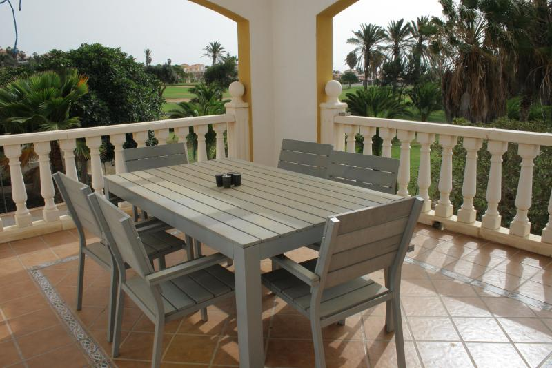 Sunny spacious balcony overlooking the golf course - a lovely outdoor dining area