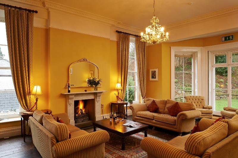 Drawing room at No 10 on the first floor with a real fire, sky TV  and access to the garden