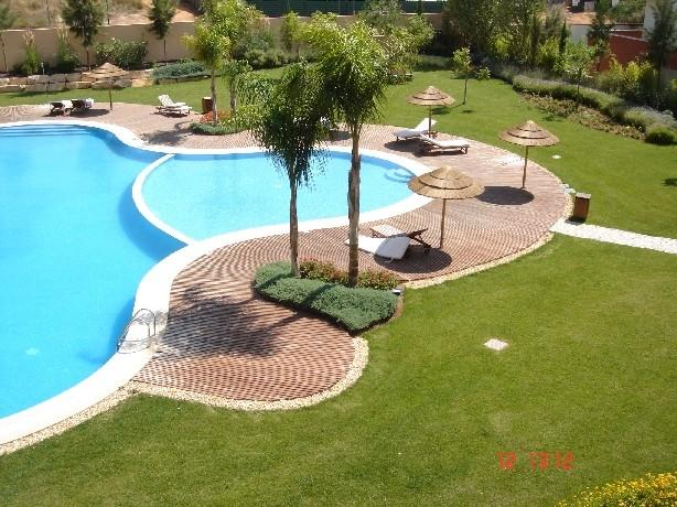 View of pool and garden from Balcony