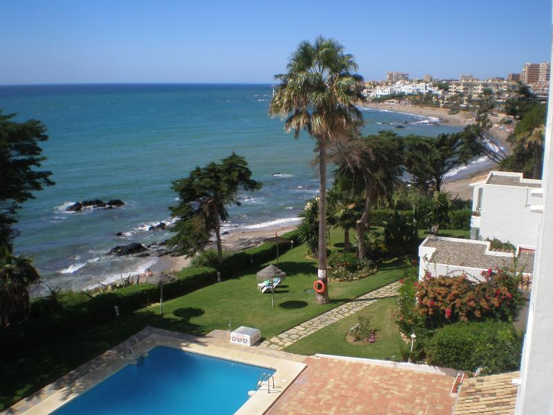 View from balcony over beach, pool and garden