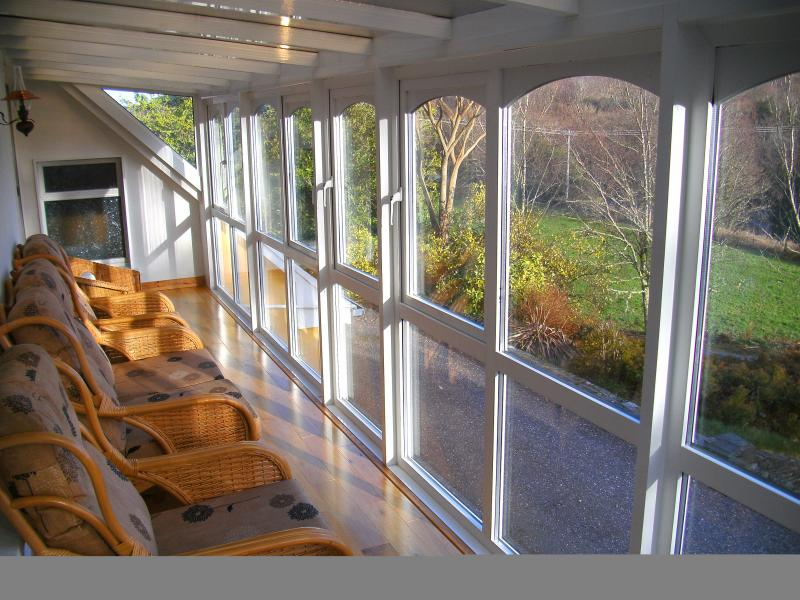Comfortable conservatory with a view of the river