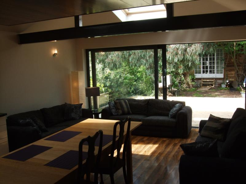 Large kitchen, dining and living room. Dining table seating 12 persons.