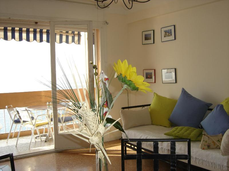 View of lounge onto balcony and sea