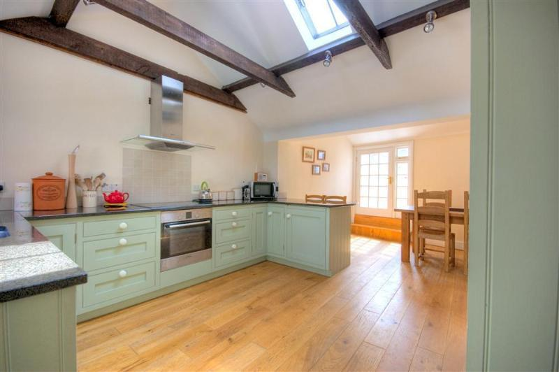 The spacious handmade kitchen with a breakfast room and dining room table