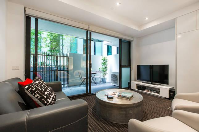 luxury living area leading to courtyard