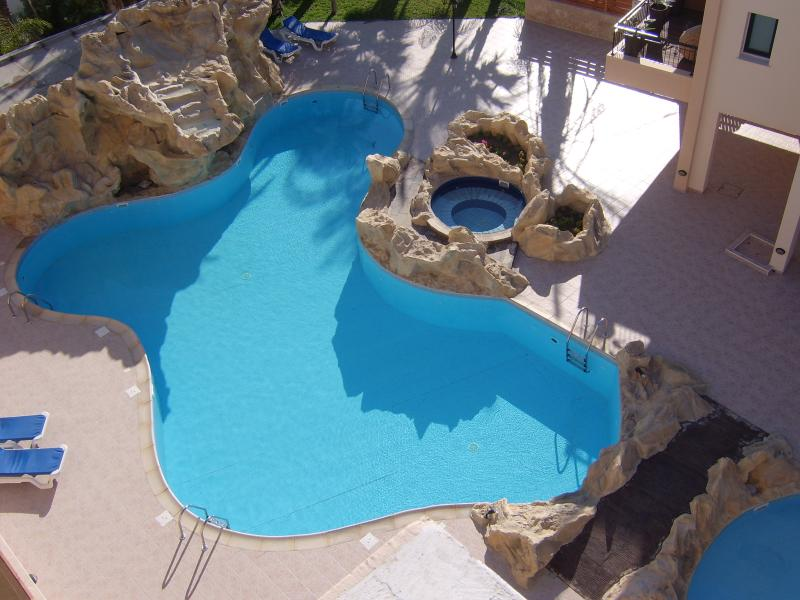 Pool with Rock Features, Waterfall and Jacuzzi NB. not the view from our Balcony