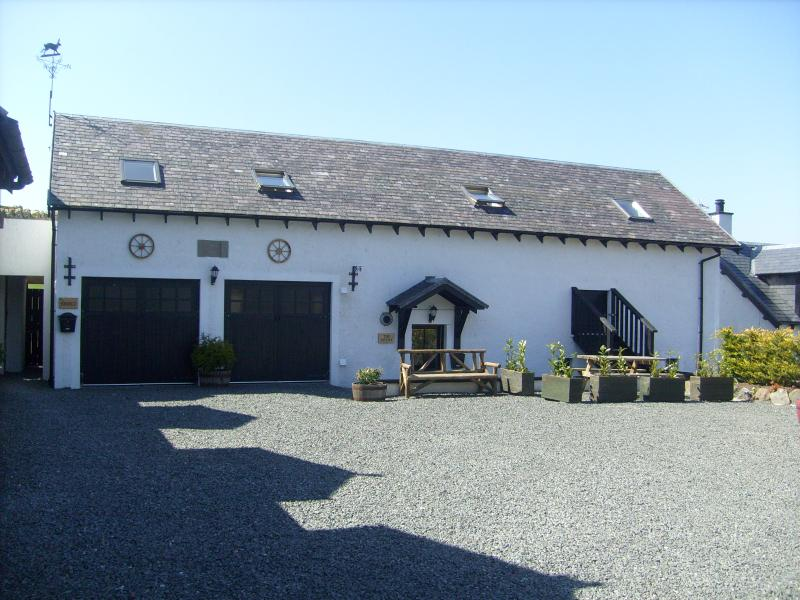 Front view of The Bothy with private parking.