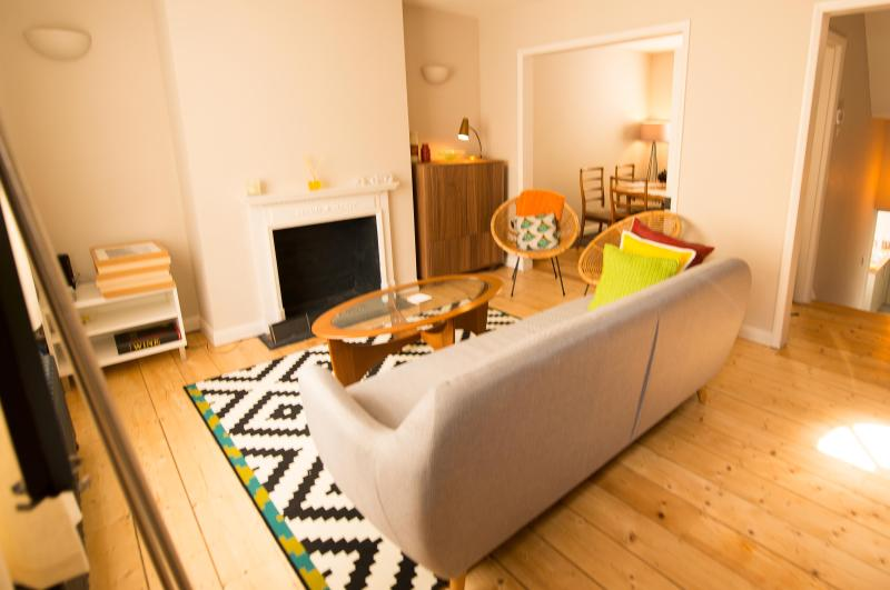 NEWLY LISTED PROPERTY Bright open plan living room with modern and vintage furniture