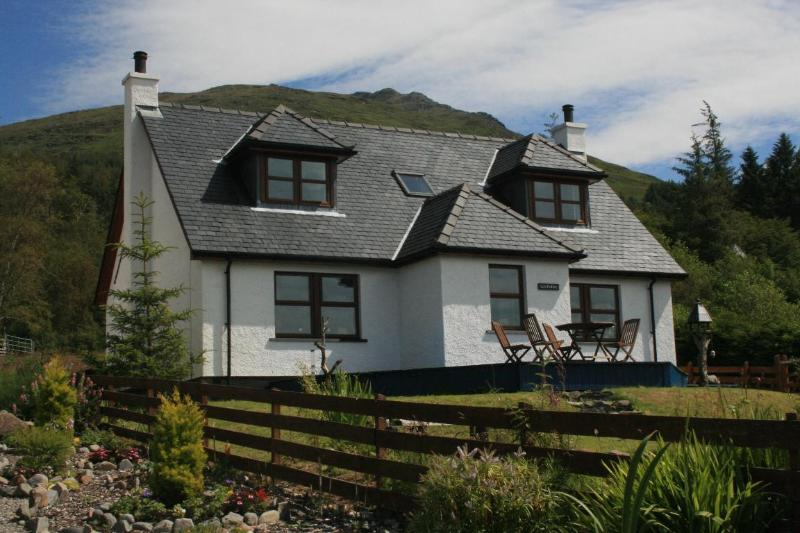 Lochside Knoydart - a contemporary Scottish Highland Cottage with views of loch and mountains.