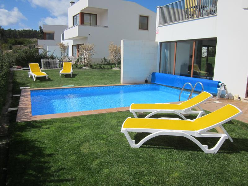 Spacious back garden and heated pool make for a relaxing, luxurious environment!