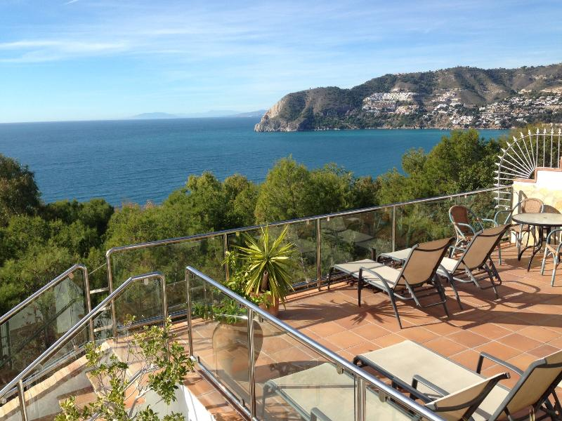 The south west facing view from the covered terrace over the bay of La Herradura.
