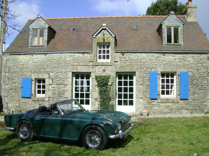 Front of cottage (with TR4A)