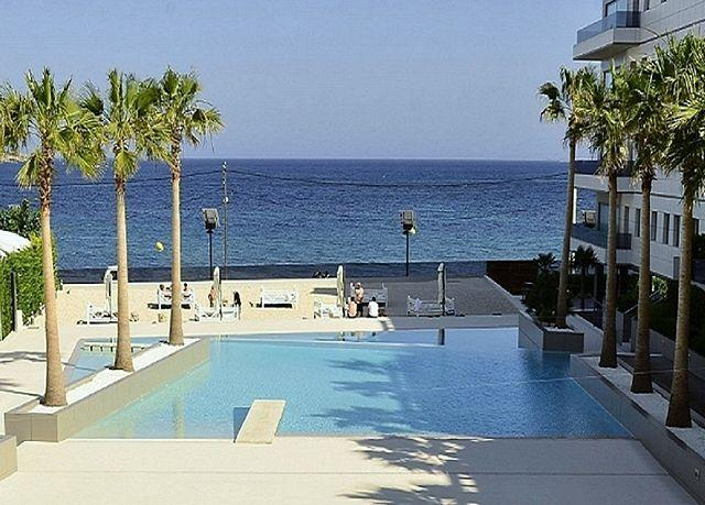 The pool and the stunning view from the private terrace