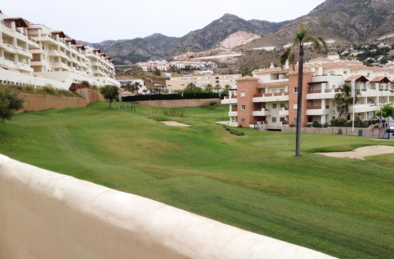Apartment Terrace mountain and golf course view.