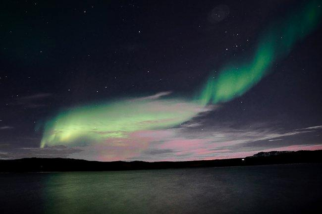 Aurora Borealis, the northern lights seen in dark and clear sky