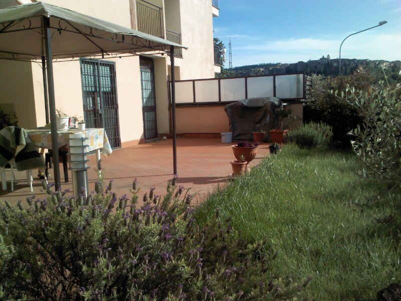terrace equipped by barbecue, outdoor table and chairs for an enjoyable dinner