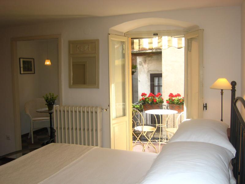 The master bedroom with balcony and private sitting room offers comfort and romance