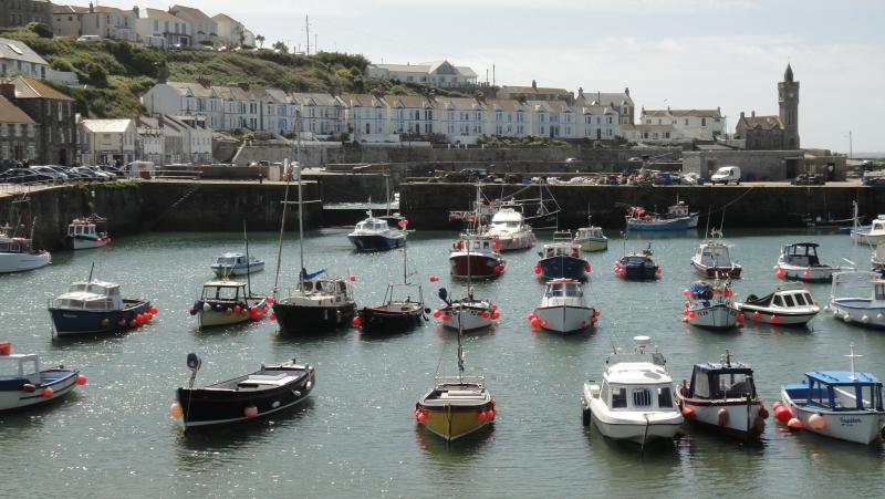 Porthleven's picturesque working harbour is surrounded by attractive shops and restaurants