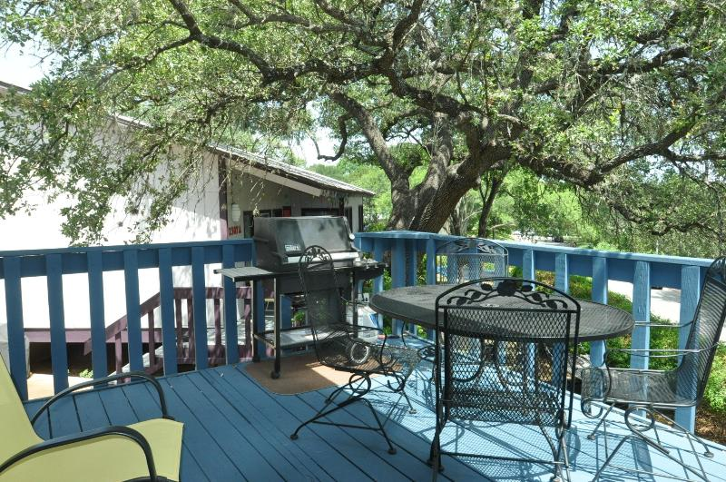 Propane gas grill and table with 4 chairs.