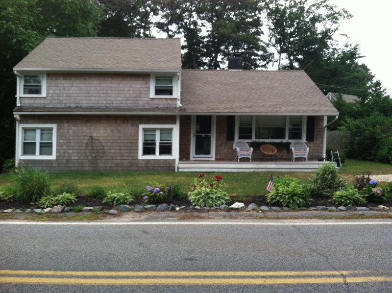This is the front of the house that shows the farmer's porch and the flower garden in front