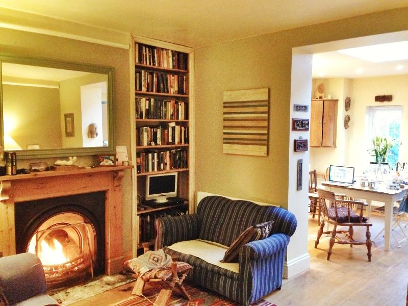 The living room opens into the large kitchen with French windows to the garden