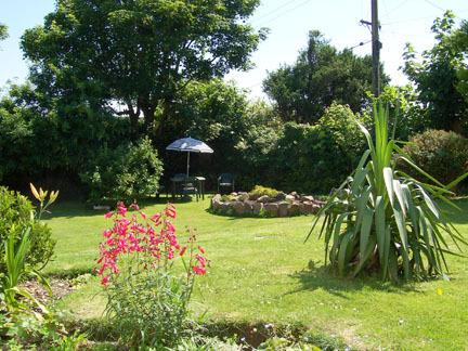 A view of the garden from the Garden Flat.It is bright and sunny with garden furniture and a BBQ