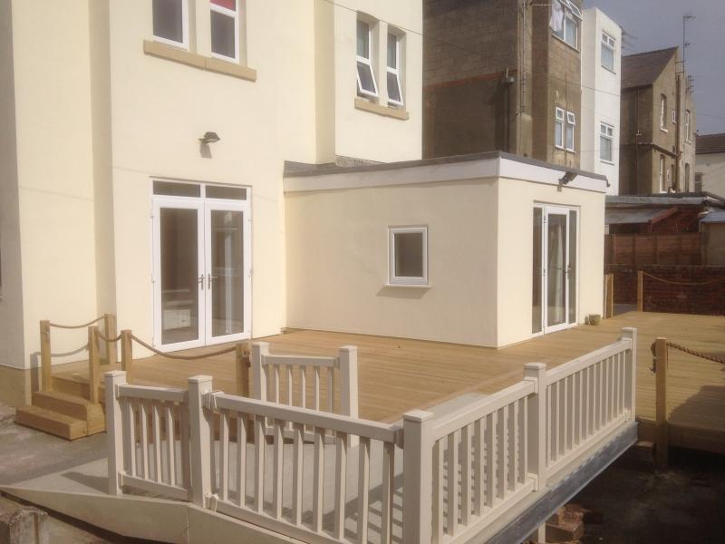 Rear bedroom leading onto decking area, catching the Blackpool sun!