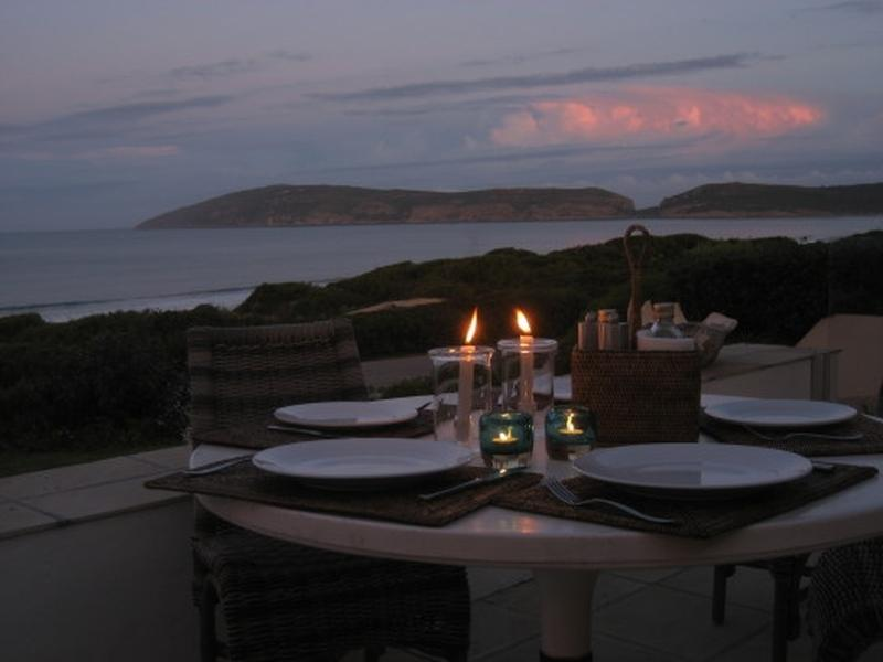 Enjoy sun-downers on the patio mesmerized by a breathtaking view of the last streaks of light ebbing