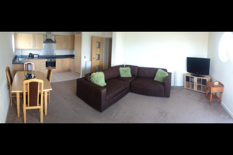 A very roomy & comfy lounge with open plan kitchen