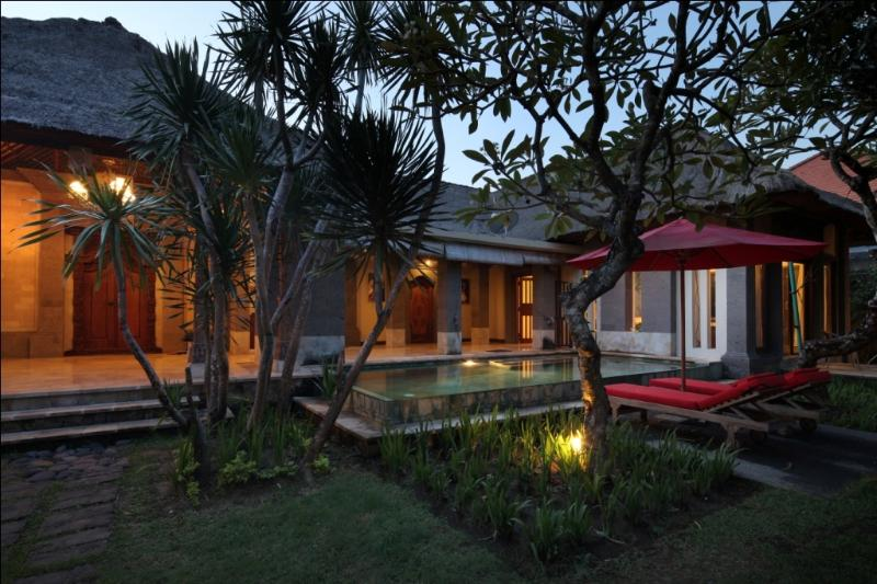 Beautiful Villa in Sanur. Surrounded by the villa pool and sun chair. Lights up at night.
