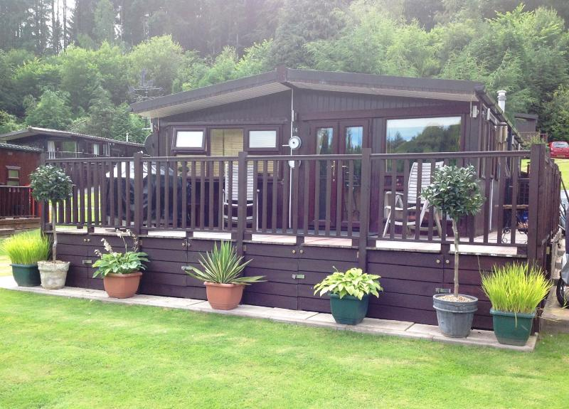 Front view of cabin, with large decking area
