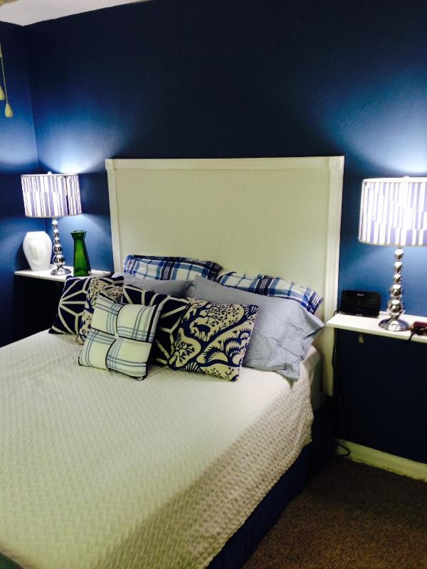 Luxe colorful bedroom with customized coordinating lamp shades.