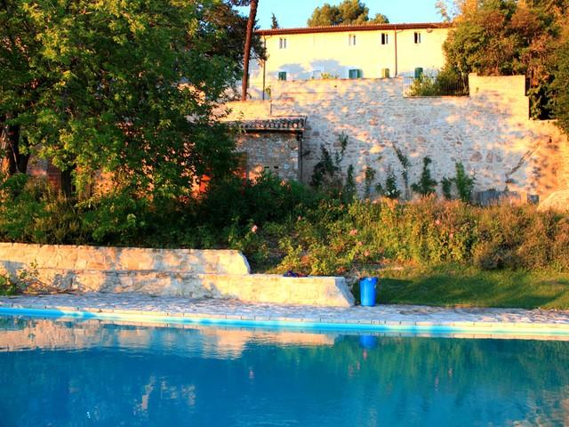 Villa Lusso + Manor House in walled grounds at sunset