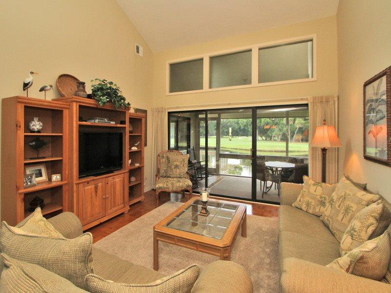 Living Room with Screen Porch Access at 553 Ocean Course