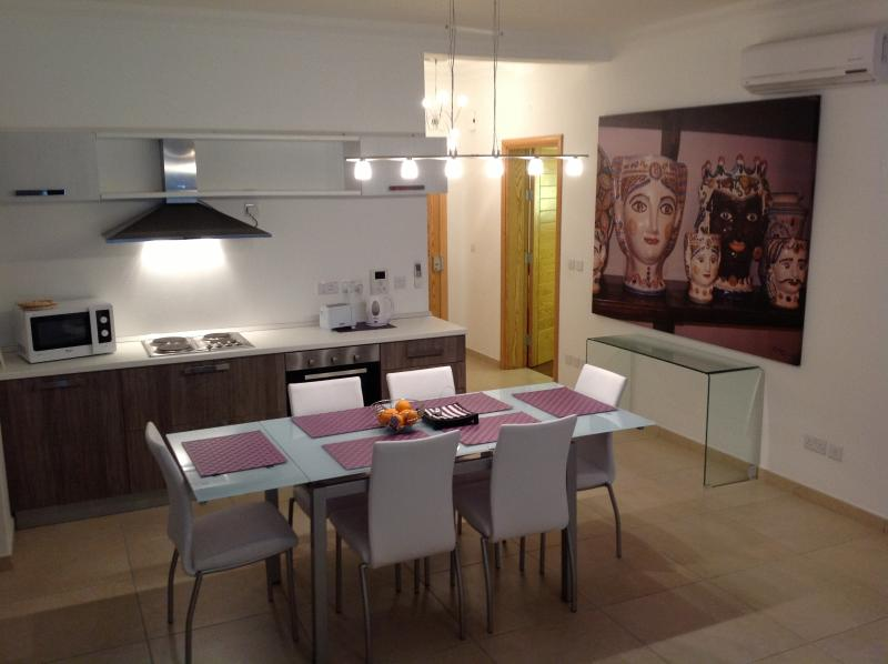Spacious open plan kitchen-living-dining area
