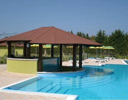 Pool bar and one of the two stunning outdoor swimming pools