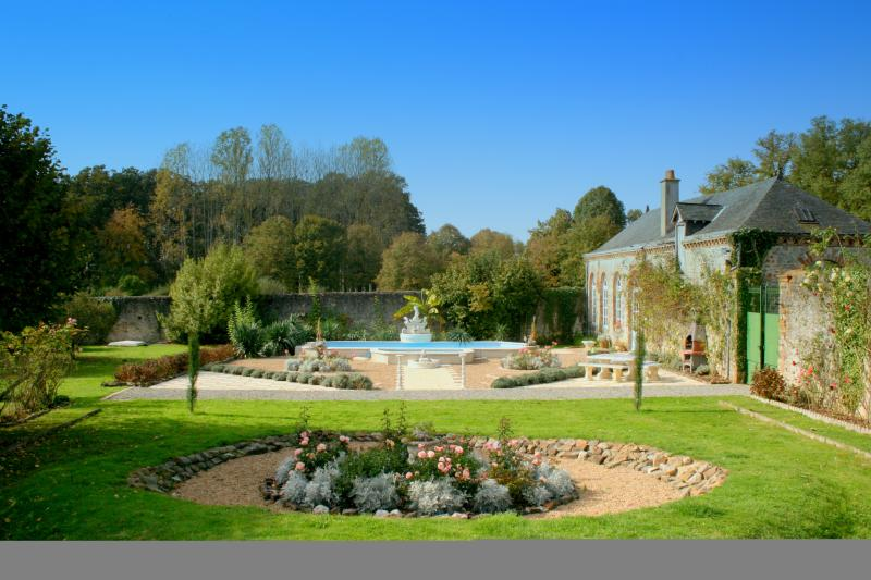 View of Pool Area and Orangery (pool house)