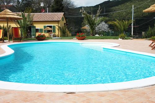 our villa and its large pool with solarium